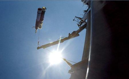A Carbon Flux Explorer hangs from a boom seconds before it drops into the ocean. (Credit: Jessica Kendall-Bar)